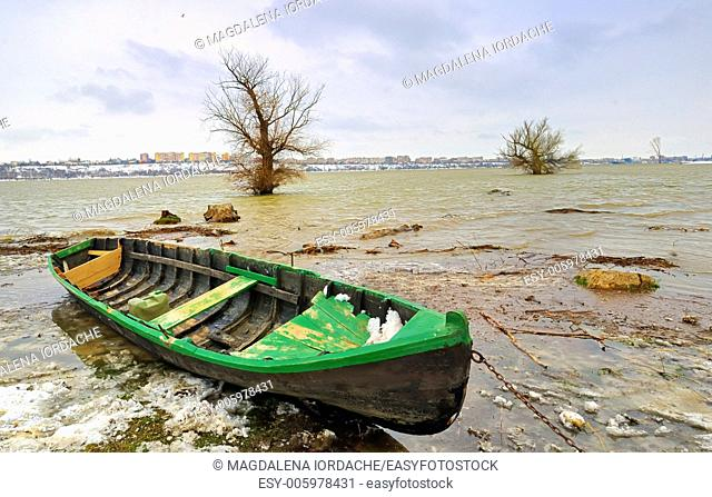 green boat on danube river in winter