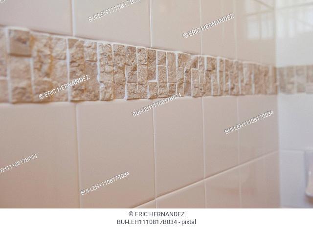Detail shot of tiled bathroom wall at home; California; USA