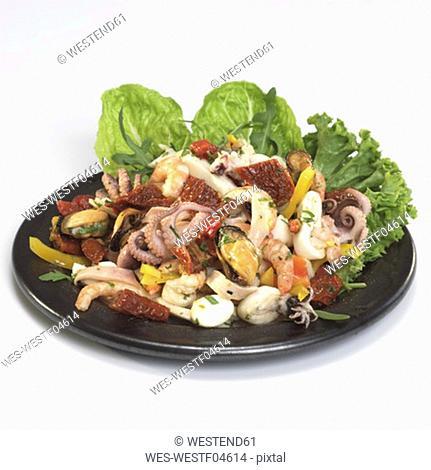 Sea-food salad on plate