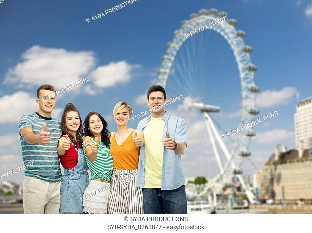 friends showing thumbs up over ferry wheel