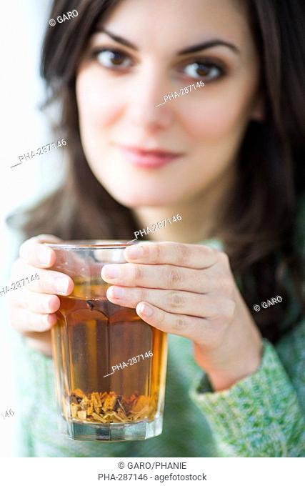 Woman drinking linden sapwood herbal tea