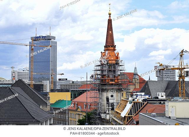 The bell tower of the Paorchial church with the new copper belt in Berlin, Germany, 5 July 2016. The 65 meter tall bell tower is being reconstructed for 3