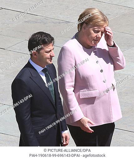 18 June 2019, Berlin: German Chancellor Angela Merkel (CDU), together with Volodymyr Selensky, President of Ukraine, trembles heavily and
