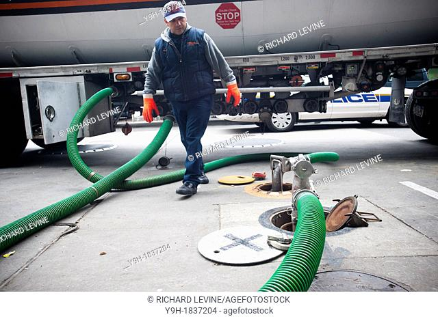 A fuel truck operator delivers gasoline to a Hess gas station in the Clinton neighborhood of Manhattan in New York Motorists and people with gas cans waited as...