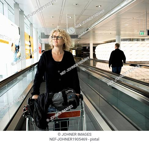 Mature woman at airport, Frankfurt, Germany