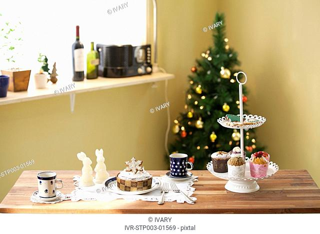 Christmas Cake And Cookies In Front Of Christmas Tree