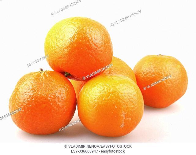 Fresh tangerine fruits on a white background