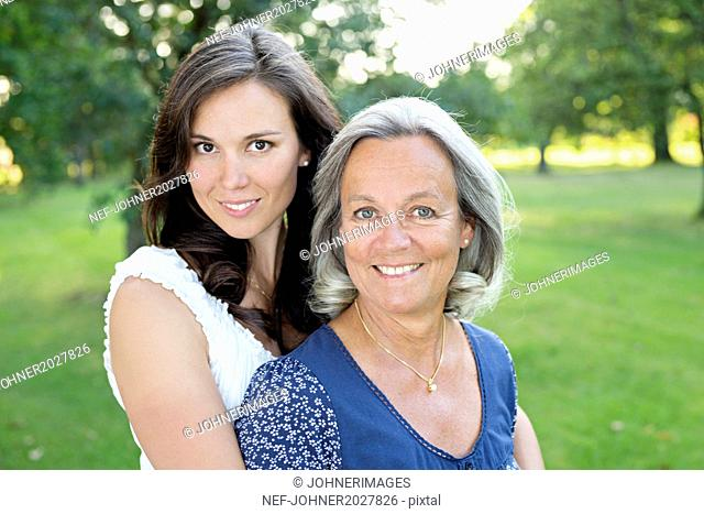 Portrait of mature woman with adult daughter