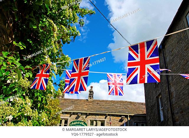 British flags hanging in the streets of small English town