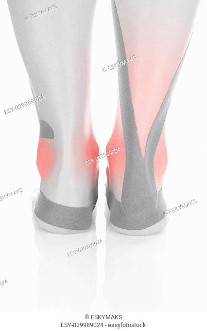 e545bf6a7e Therapeutic tape on female heel isolated on white background. Chronic pain,  alternative medicine.