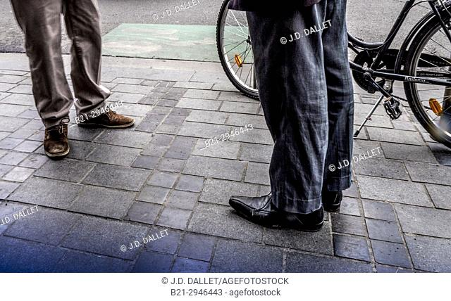men waiting in the street