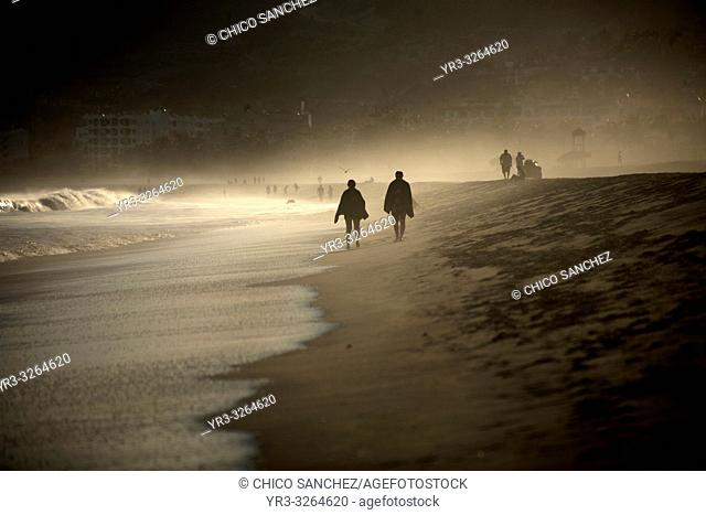 A couple walks in a beach in San Jose del Cabo, Baja California, Mexico