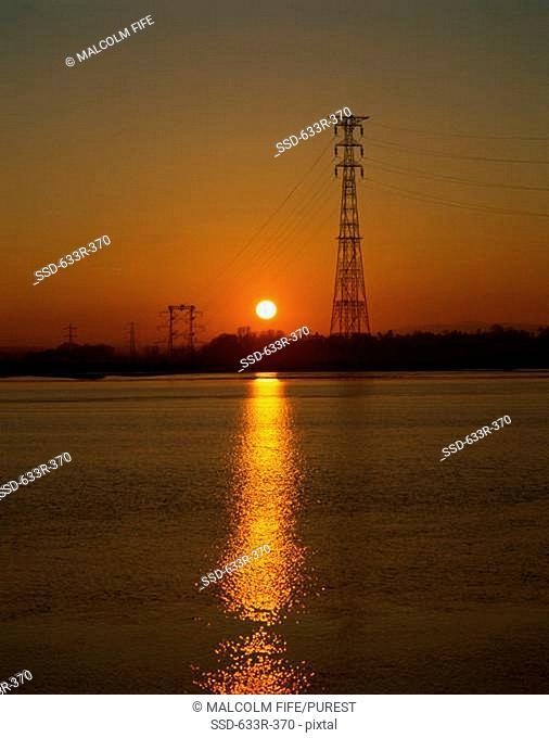 Electricity pylon across River Forth during sunset, Kincardine, Scotland