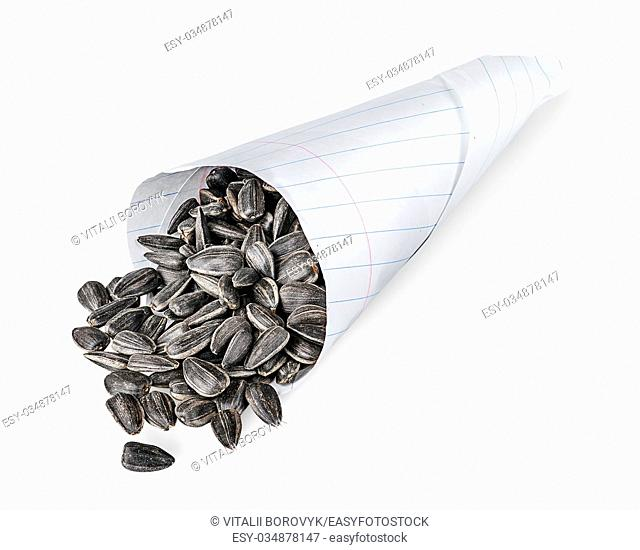 Sunflower seeds in paper packet isolated on white background