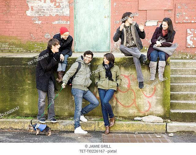 Group of friends sitting in urban scene