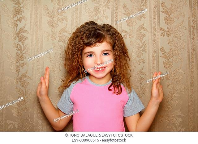 little girl happy funny expression on vintage retro wallpaper