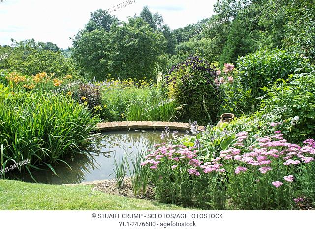 Water feature and flower border at Coton Manor Gardens