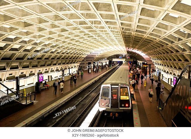 Commuter waits for metro, Washington DC, USA