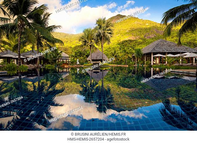Seychelles, Silhouette Island, Hilton Seychelles Labriz Resort & Spa, Mont Dauban is mirrored in the pool