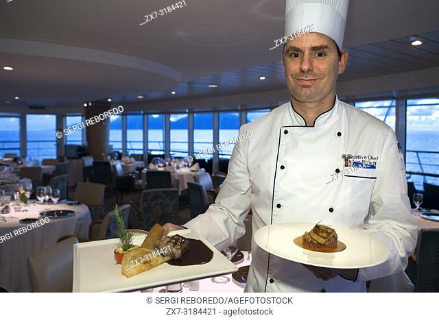 Stefan Berndt, the executive chef of Paul Gauguin show some dishes of the restaurant, 2-star Michelin. Paul Gauguin cruise, Society Islands