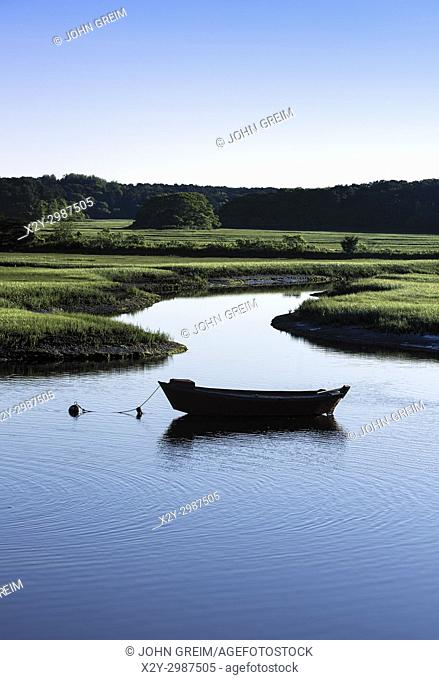 Dory moored in the Herring River, Harwich, Cape Cod, Massachusetts, USA