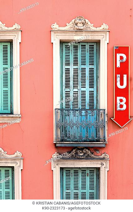 Facade of a house with the sign for a pub on the wall, Nice, France, Europe