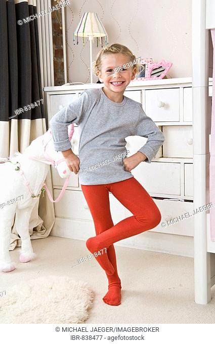 A girl in tights in the nursery