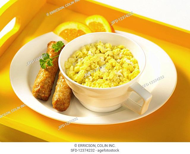 Scrambled eggs and sausages for breakfast