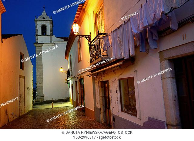 Rua Henrique Correia da Silva at night, in background belltower of Santa Maria church, historic part of Lagos, Algarve, Portugal, Europe