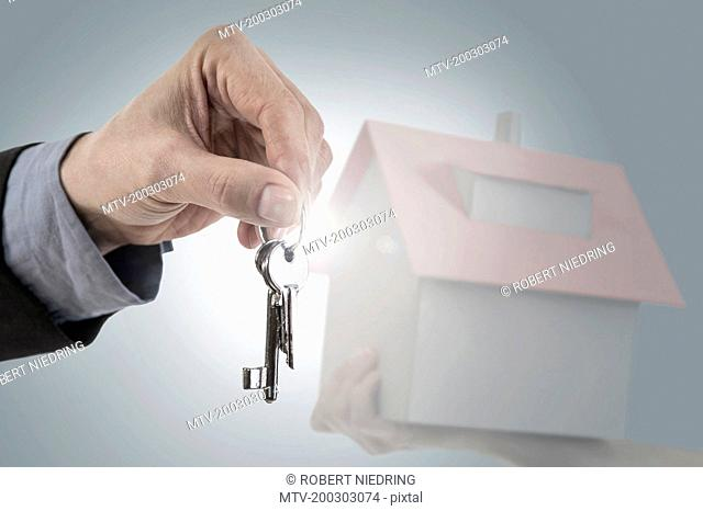 Close-up of a businessman's hand holding house keys, Bavaria, Germany