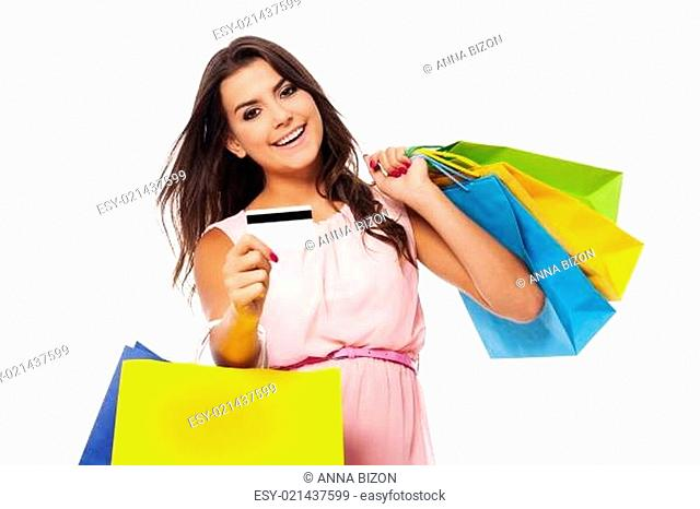 Gorgeous female with multi colored shopping bag and credit card