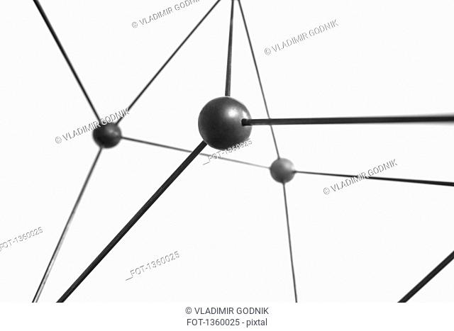 Close-up of black molecular structure over white background