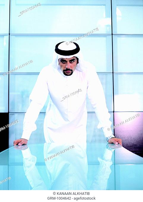 Arab businessman standing at conference table