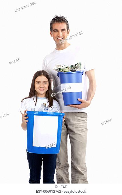Portrait of happy father and daughter holding recycle bin