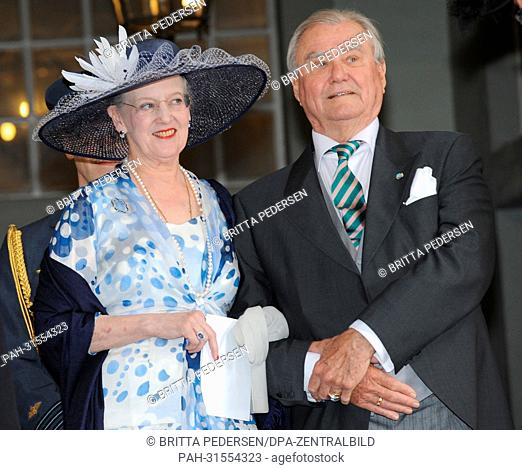 Danish Queen Margrethe and Prince Consort Henrik leave after the christening of the Swedish Princess Estelle at the Royal Chapel (Slottskyrkan) in Stockholm