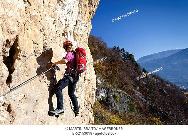 Climber ascending Monte Albano along the climbing route above Mori, Lake Garda hills, Rovereto, Trento, Italy, Europe
