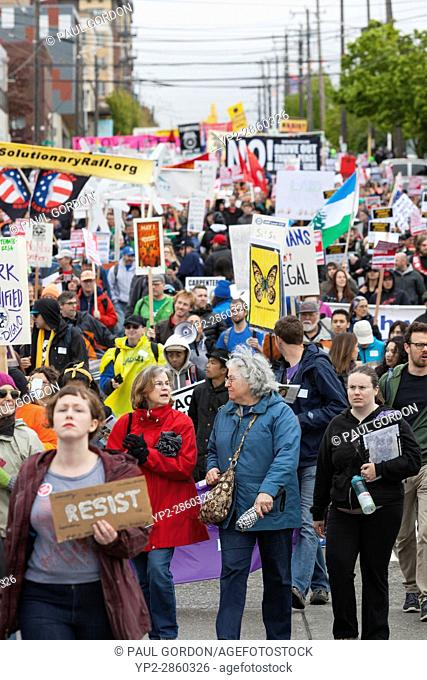 Seattle, Washington: Supporters crowd Jackson Street during the May Day March for Workers and Immigrant Rights. Organizers called for a general strike on...