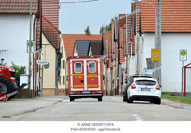 A measuring vehichle from the dangerous substances division drives through the streets of Harthausen near Speyer, Germany, 29 September 2013