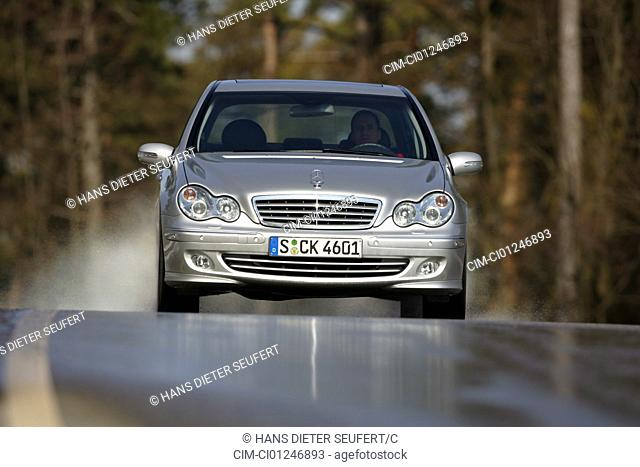 Car, Mercedes C 220 CDI, model year 2005-, silver, medium class, Limousine, driving, frontal view, country road