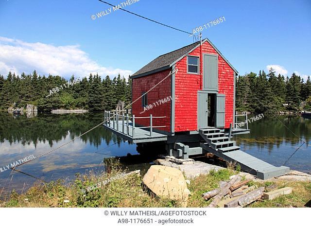 red fish shack on water near world heritage city of Lunenburg, Mahone Bay, Nova Scotia, Canada, North America
