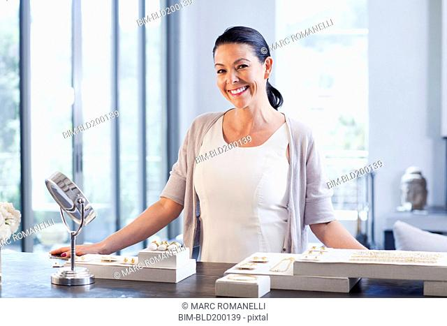 Hispanic woman working in jewelry store