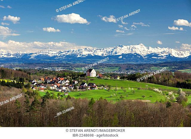 View of the Alps in April, with Saentis mountain, Alpstein mountain and the castle in Freudental, region around Lake Constance, Baden-Wuerttemberg, Germany