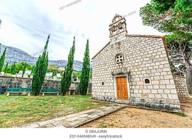 Virgin Mary church on graveyard in Tucepi, Croatia