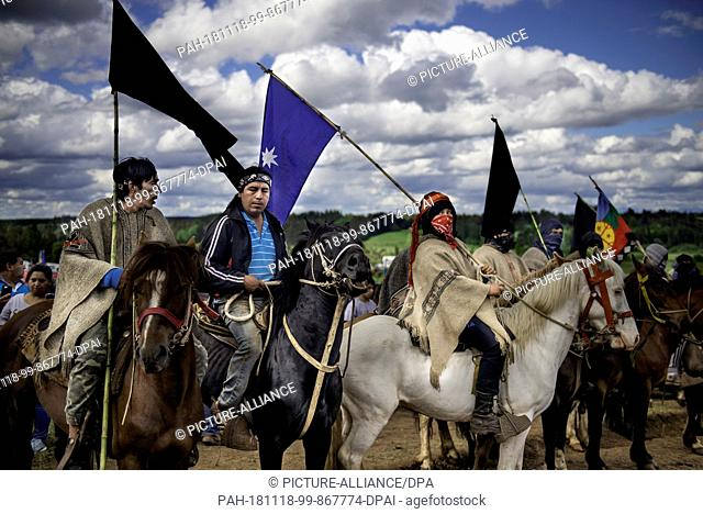 "17 November 2018, Chile, Temucuicui: """"Weichafe"""", fighters from the indigenous Mapuche people, on horseback, take part in the funeral of 24-year-old Camilo..."