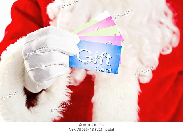 Mid section of Santa holding gift cards