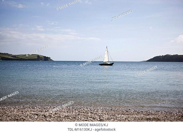 A boat sailing across a bay, Cornwall