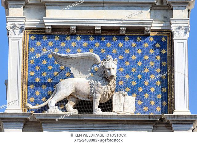 Venice, Venice Province, Veneto, Italy. The winged lion with the book is an iconic symbol of Venice. This one is on the Torre dell'Orologio, or the Clock Tower