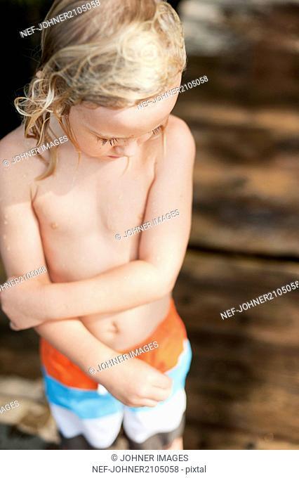Little boy in with wet hair