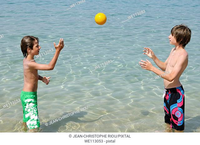 Two boys playing on the beach