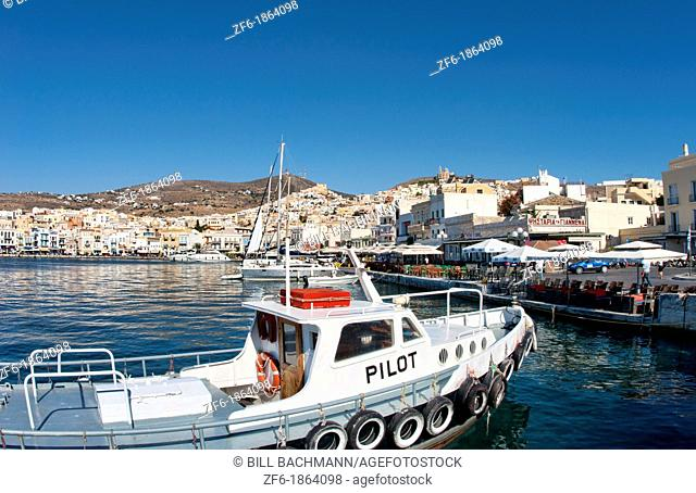 Syros Greece Islands in Hermoupolis capital in marina harbor boats ships port white buildings water boating fishing architecture